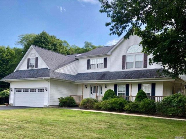 4 BR,  3.50 BTH  Colonial style home in Center Moriches
